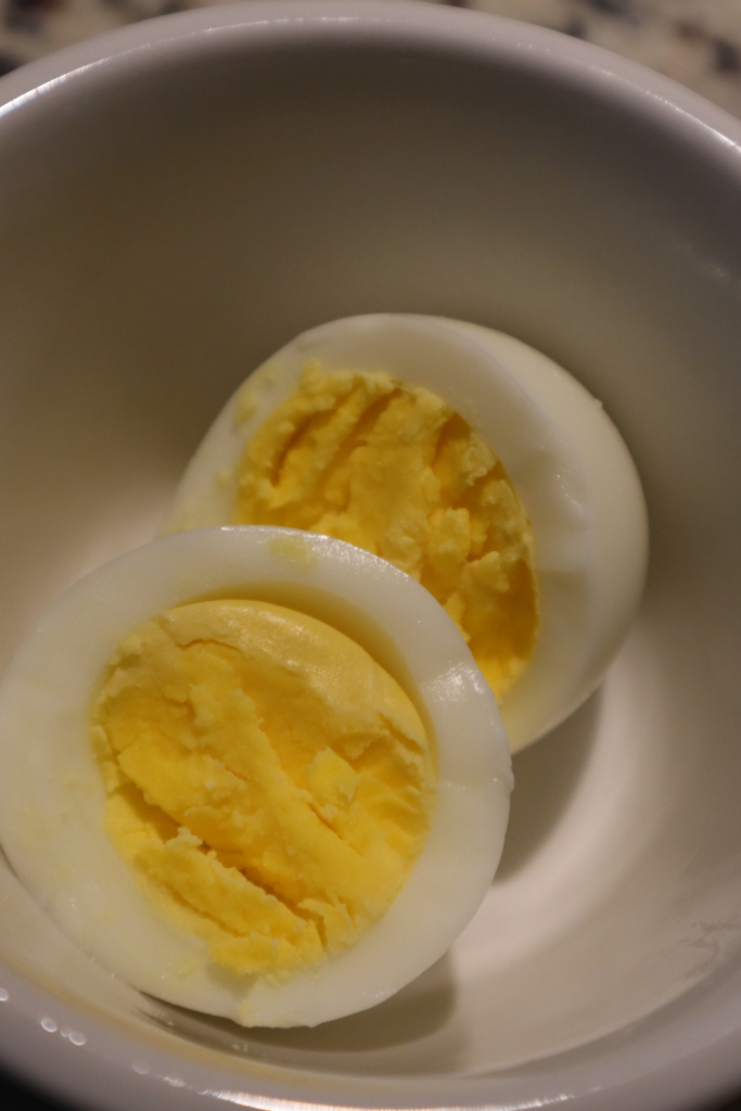 Hard Boiled Egg in white bowl cut in halves