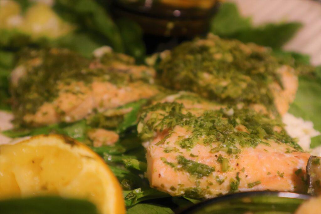 fresh herb seasoning on salmon filets