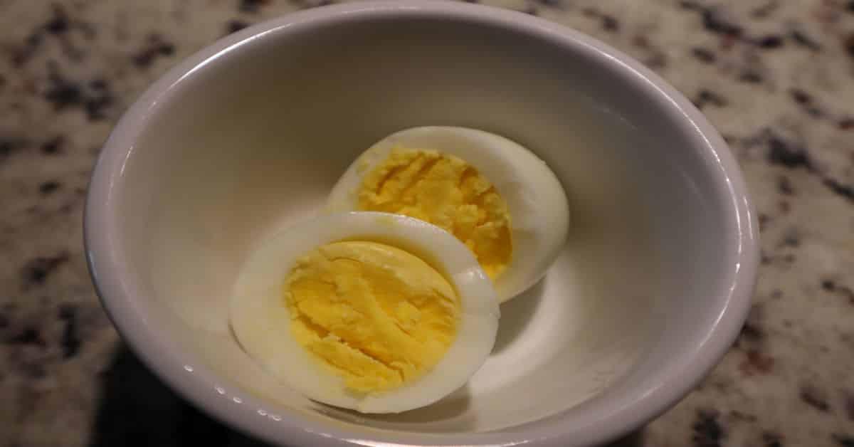 Hard Boiled Egg in white bowl cut in halves