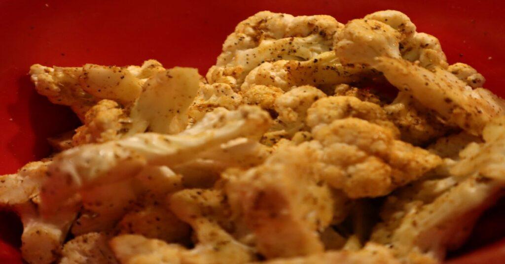 Raw Head of Cauliflower Close Up With Seasoning