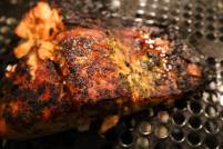 Blackened Salmon cooked in broiler setting on a black grated tray