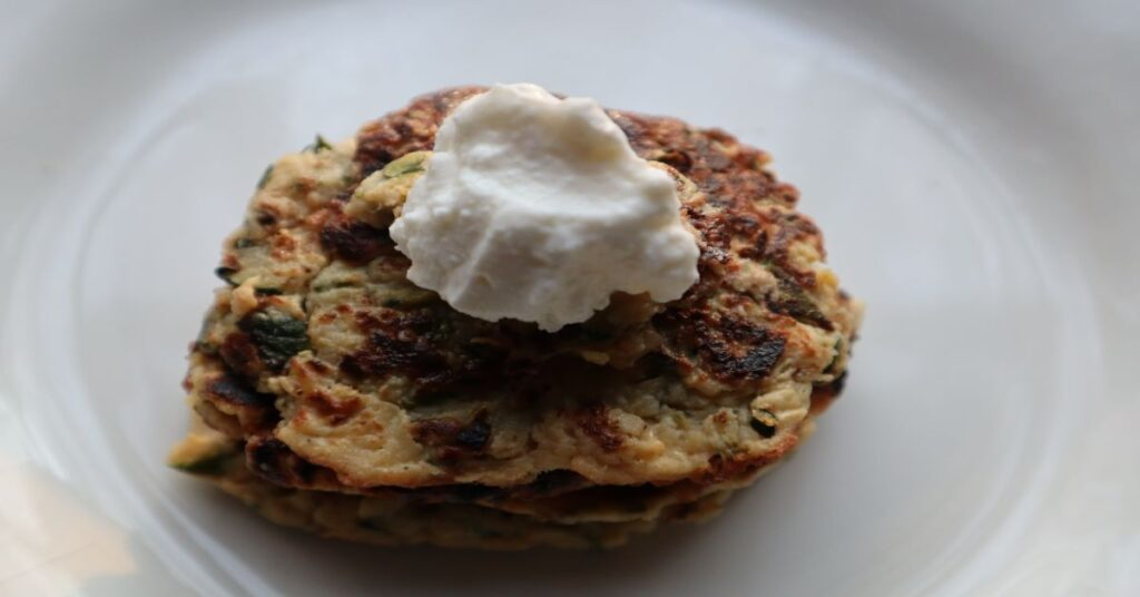 Easy Vegan Zucchini Fritters topped with Fage
