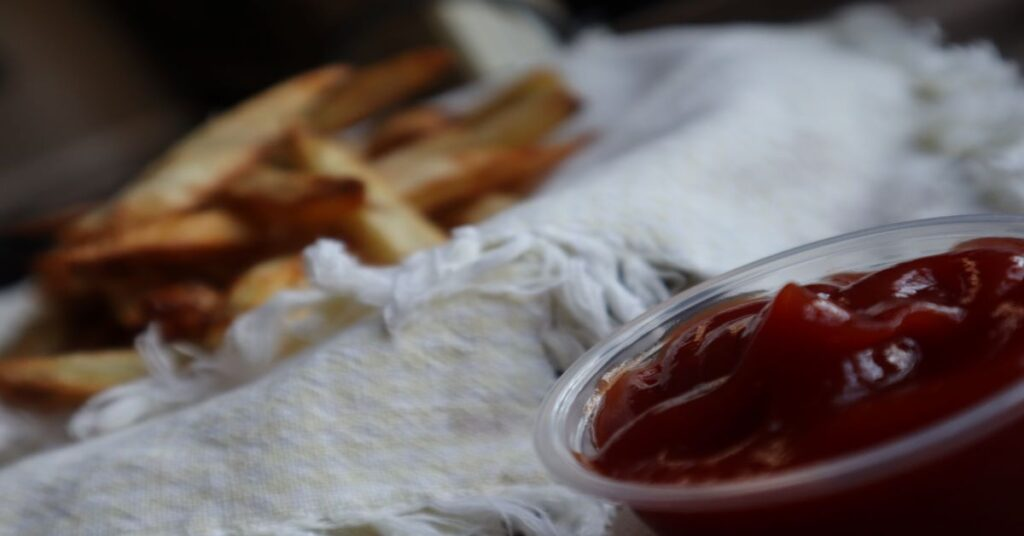 Crispy Homemade Air Fryer French Fries with ketchup ramekin nearby