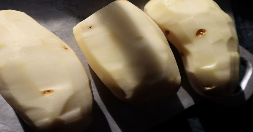 three raw potatoes peeled