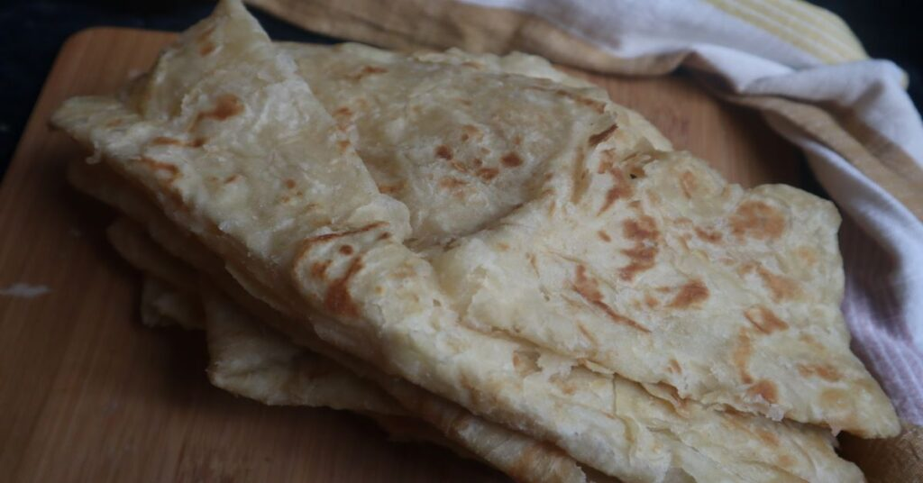 Finished Paratha Roti with a kitchen towel in background