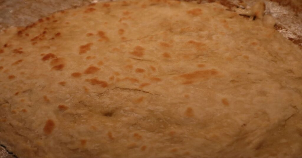 Roti on the cooking device after turned