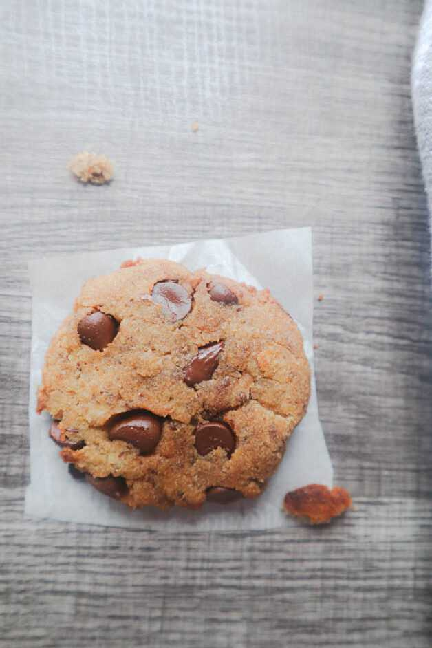 Vegan Banana Chocolate Chip Cookie on a square piece of white parchment paper