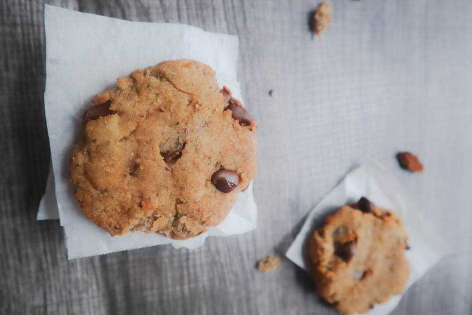 Two Vegan Banana Chocolate Chip Cookies on Parchment paper