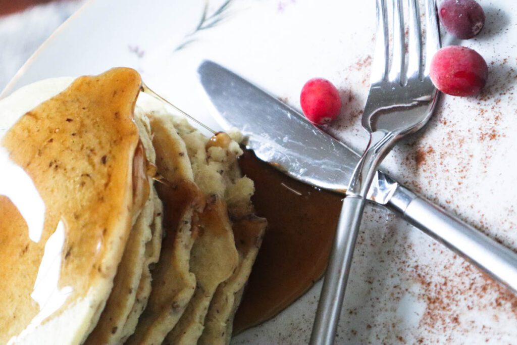 Stack of pancakes with knife and fork next to it
