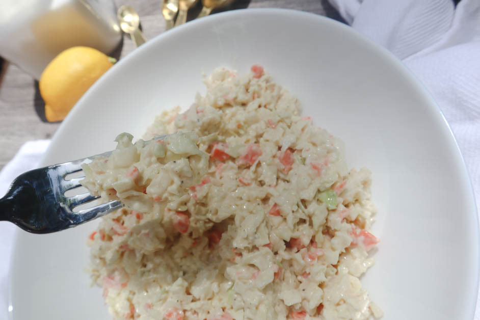 creamy coleslaw in a white bowl